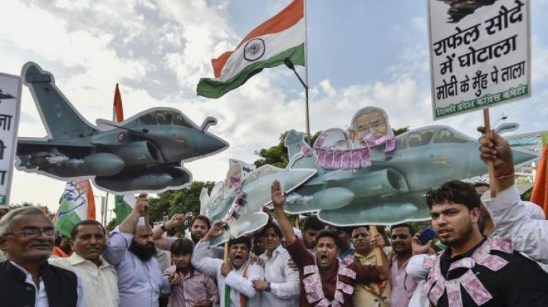 The Congress has asked why the government was not setting up a joint parliamentary committee to probe the fighter jet deal. (Photo: PTI)