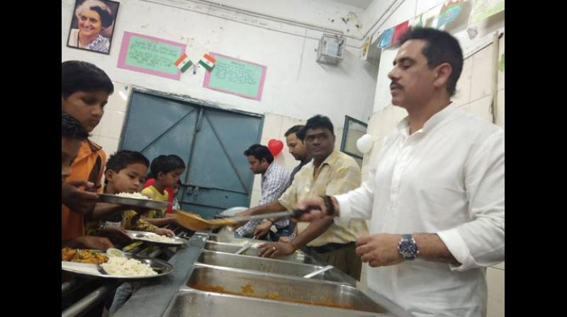 UPA chairperson Sonia Gandhi's son-in-law Robert Vadra kickstarted his birthday week celebrations at an NGO where he spent time with children, the elderly and the poor, among others. (Photo: ANI)