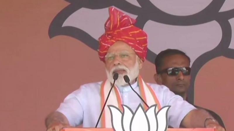 Modi, while addressing the gathering here, also said those who have looted the country 'will have to pay back.' (Photo: ANI twitter)