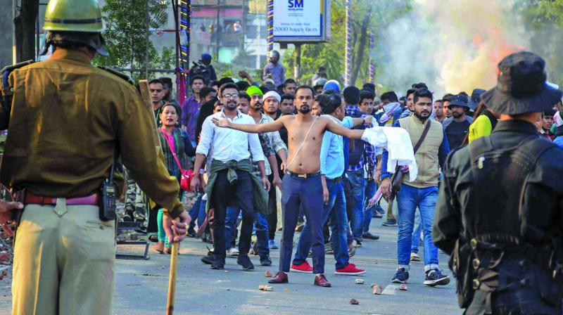 Protesters clash with the police during their march against the Citizenship (Amendment) Bill in Guwahati. (Photo: PTI)
