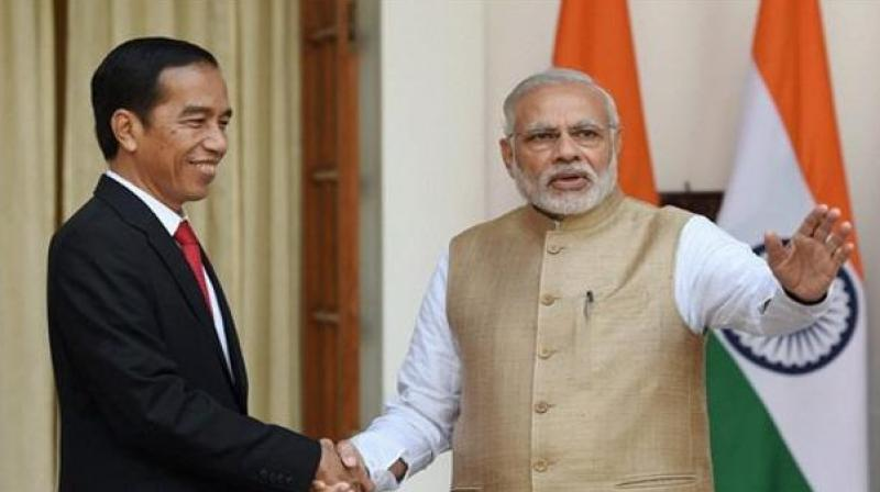 Both leaders agreed to address all issues related to obstacles to trade and investment in palm oil products and industries, the joint statement said. (Photo: AP)