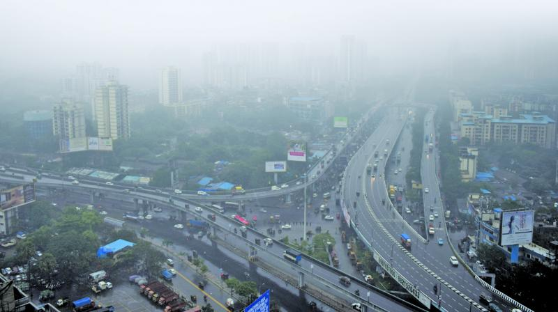 File image of the city roads being obscurred by fog.