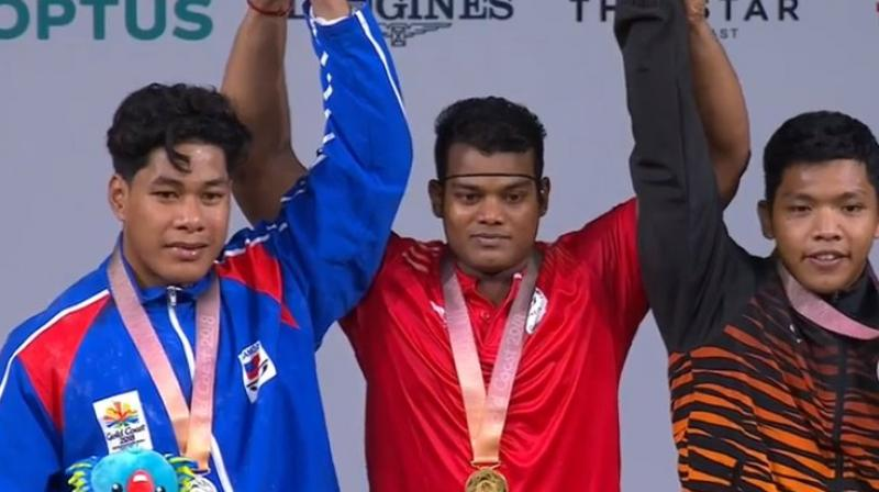 Satish Sivalingam(centre) finished at the top position in the men's 85kg weightlifting final. (Photo: Twitter / IOA)