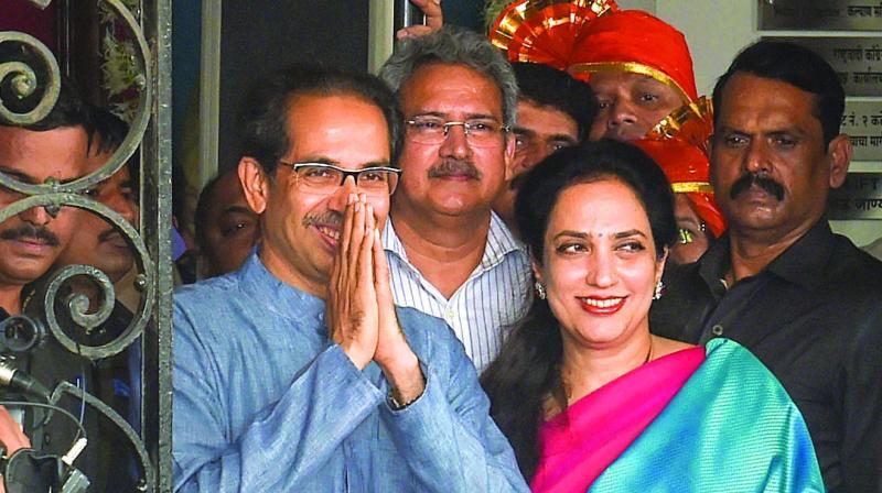 Shiv Sena president Uddhav Thackeray with his wife Rashmi leaves BMC headquarters after felicitating Mumbai's newly-elected mayor Kishori Pednekar on Friday. (Photo: PTI)