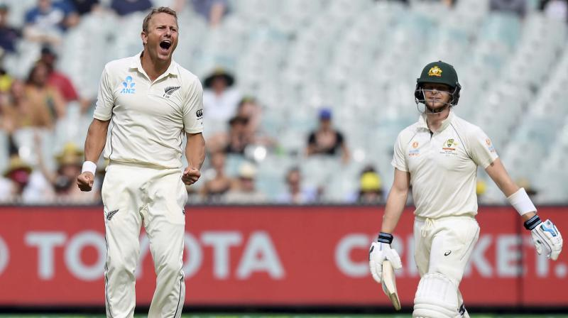 When Steve Smith departed for seven,Neil Wagner's 200th Test wicket, the Black Caps were on a roll. But Travis Head and Matthew Wade steered them to the close, leaving New Zealand with a monumental task. (Photo:AP/PTI)