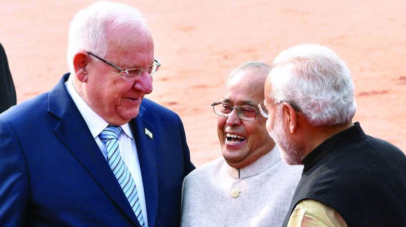 Israeli President Reuven Rivlin, President Pranab Mukherjee and PM Narendra Modi share a light moment in New Delhi on Tuesday.(Photo: PTI)