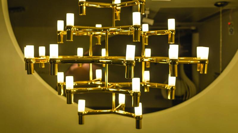 Clean lines with dynamic geometric-shaped lights can be made using different materials such as metal and wood.