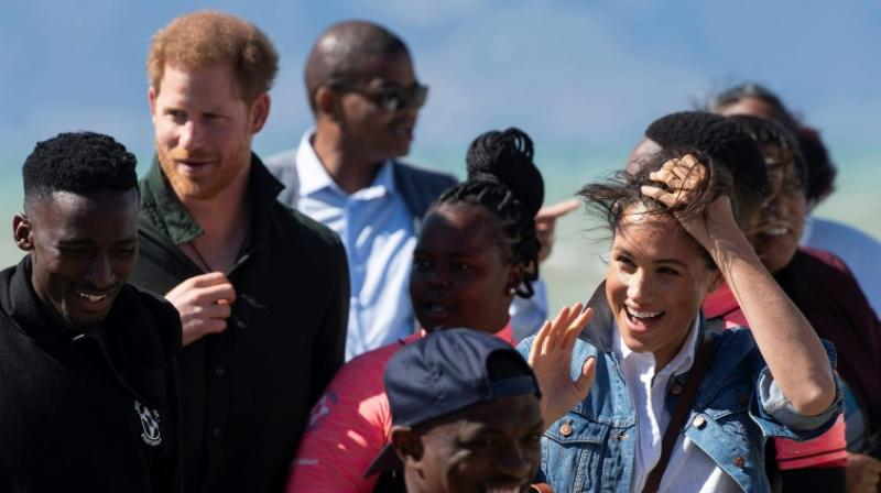 The star of the visit -- little Archie -- has so far been out of sight, to the chagrin of royal-watchers. (Photo: AFP)