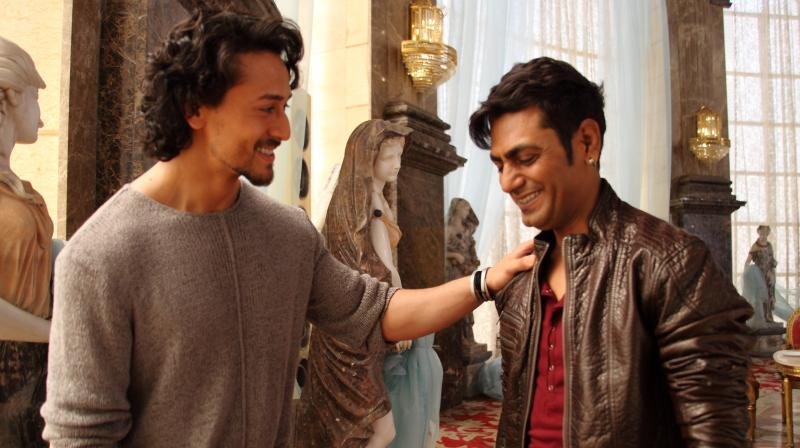 Tiger and Nawazuddin share a light moment while filming 'Munna Michael'.
