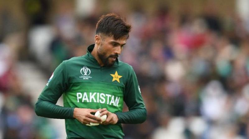 Following Mohammad Amir's like, the Pakistani fans have got infuriated, and they started believing that the Pakistani cricketer is doing all of this to get his British passport. (Photo:AFP)