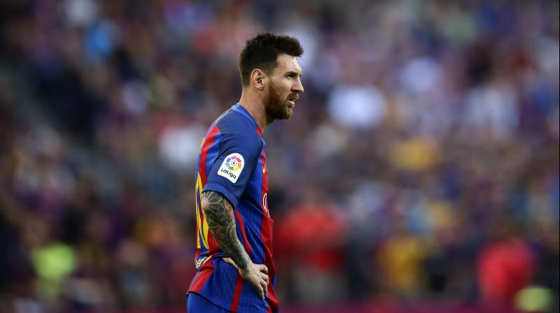 Barcelona captain Leo Messi is out of action less than two weeks ahead of the opening of La Liga season after injuring his right calf in training on Monday. (Photo: AP)