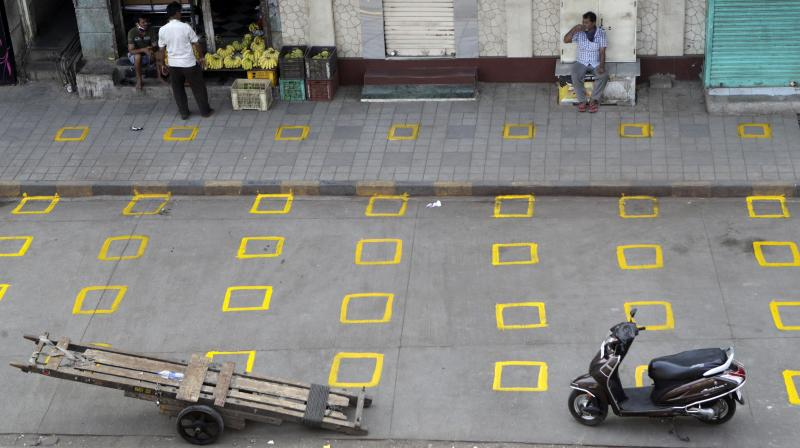 Positions are marked for maintaining physical distance at a market place in Mumbai, March 27, 2020. (AP)