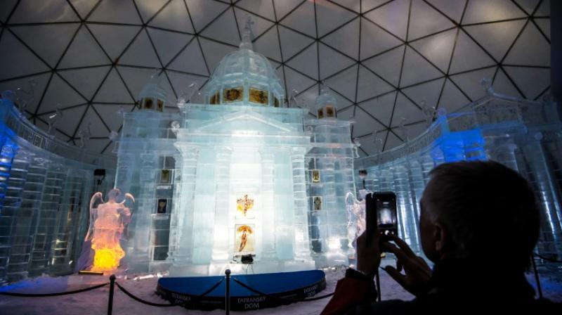 Sculptors flock to the Slovak Tatra mountain hamlet of Hrebienok every winter to build an ice version of a famous church. (Photo: AFP)