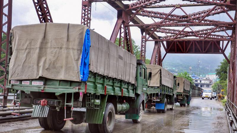 Indian Army trucks move towards Leh via Manali-Leh road, near Manali, Monday. PTI Photo