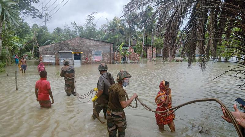 East Midnapore: Indian Army personnel carry out rescue and relief works during landfall process of Cyclone Yaas in East Midnapore district. (Photo: PTI)