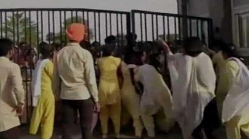 Students protest against hostel warden for forcing girls to strip at Akal University. (Photo: ANI)