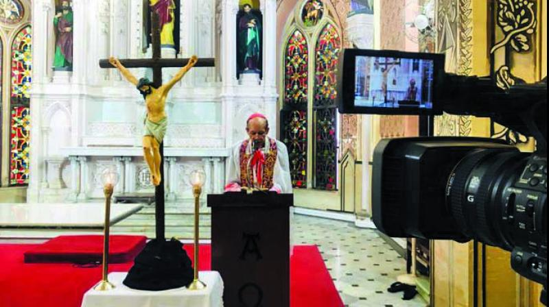 His Eminence, Oswald Cardinal Gracias, conducting the Way of the Cross at the Cathedral of the Holy Name