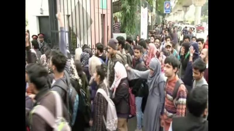 Scores of students from Jamia Millia Islamia (JMI) University staged a protest against the Citizenship (Amendment) Act 2019 on Saturday in New Delhi. (Photo: ANI)