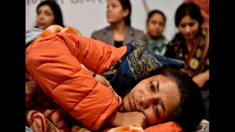 Appealing for a similar law, Maliwal said: 'I fervently appeal to you to immediately enact the Disha Bill for the entire country. I have lost more than 8 kg in these 12 days and am in immense physical pain but I assure you that I will continue this indefinite fast until 'Disha' law is enacted in the country.' (Photo: ANI)