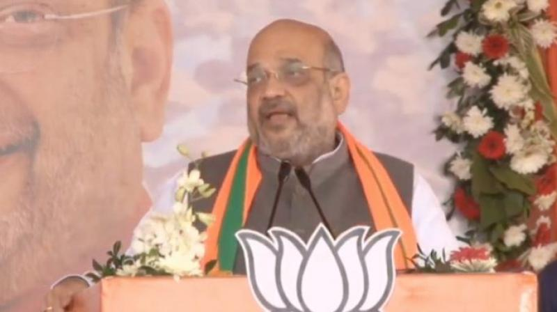 'Rahul Gandhi and Hemant Soren say why is Kashmir issue important in Jharkhand elections?... The youth of this state are securing the borders of this country. But, Rahul Gandhi does not know history as he has Italian sunglasses in front of his eyes,' Amit Shah said. (Photo: twitter | @BJP4India)