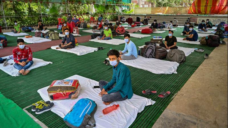 Students who were stranded in Kota due to ongoing COVID-19 lockdown, seen at a quarantine centre after they were brought by UP Government buses in Prayagraj. PTI photo