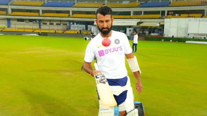Ahead of India's first day and night Test match, batsman Cheteshwar Pujara is finding it difficult to keep his eyes away from the pink ball. (Photo:Twitter)