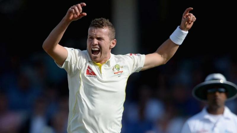 Fast bowler Peter Siddle believes that if he keeps on performing well in the domestic tournaments, he may don the white jersey for Australia again. (Photo:AFP)