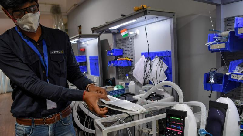 In this photo taken on March 25, 2020, AgVa Healthcare employee Vaibhav Gupta demonstrates using a ventilator at the research and development (R&D) centre in Noida in Uttar Pradesh state. AFP Photo