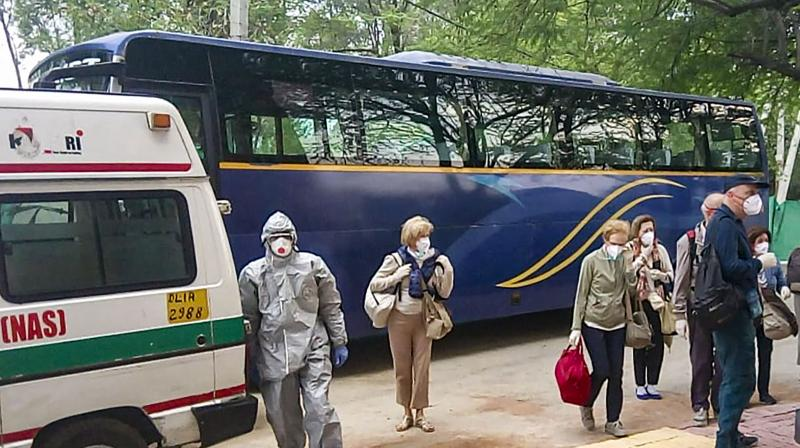 21 Italians tested positive for the coronavirus leave from ITBP quarantine facility for their treatment at designated hospitals, in Chhawla. PTI photo