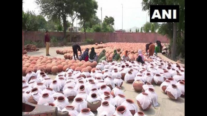 'Use of plastic is harmful to humans and the environment. Several lakhs of people will be participating at the PM's rally. These earthen pots have been arranged for them. We have bought these pots from Rohtak and nearby districts,' said Jain the media advisor to Haryana Chief Minister. (Photo: ANI)