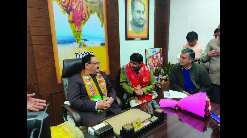 BJP national president J.P. Nadda with city unit chief Manoj Tiwari at party's Delhi unit headquarters where he visited unannounced on Friday.