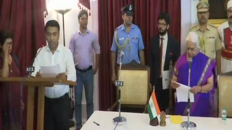 After multiple postponements of the oath ceremony on Monday, the day when his predecessor Manohar Parrikar was cremated with state honours, Sawant was sworn in by Goa governor Mridula Sinha at Raj Bhavan at 1.50 am. (Photo: ANI)