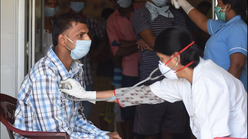 Medics examine patients during a government-imposed nationwide lockdown to curb the spread of coronavirus, in Chennai. PTI Photo