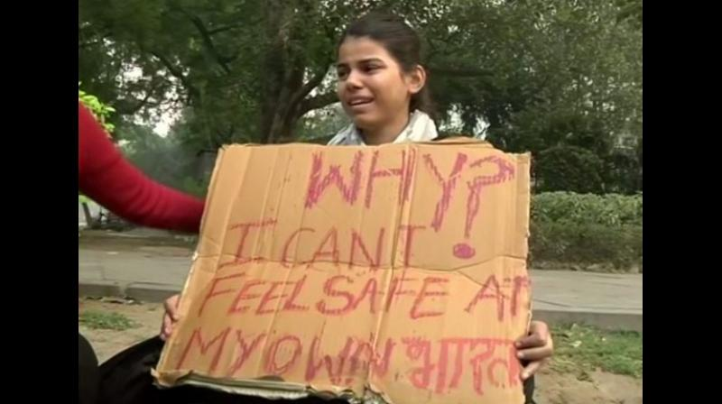 The young girl identified as Anu was seen venting anger on the Delhi Police officials when they asked her not to sit in the area. (Photo: ANI)