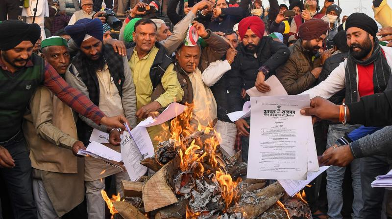 The agitating farmers' on Wednesday received a boost as a delegation of 1,000-odd Kerala farmers aligned with the All India Kisan Sabha's Kerala unit decided to join the agitation at Delhi border on Thursday. (Photo:AFP)