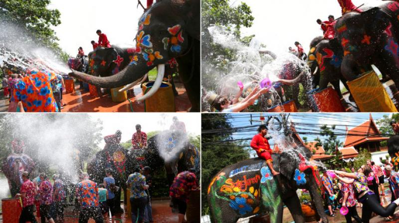 Thailand celebrates the start of the Buddhist New Year festival with elephants spraying water on tourists. (Photo: AP)