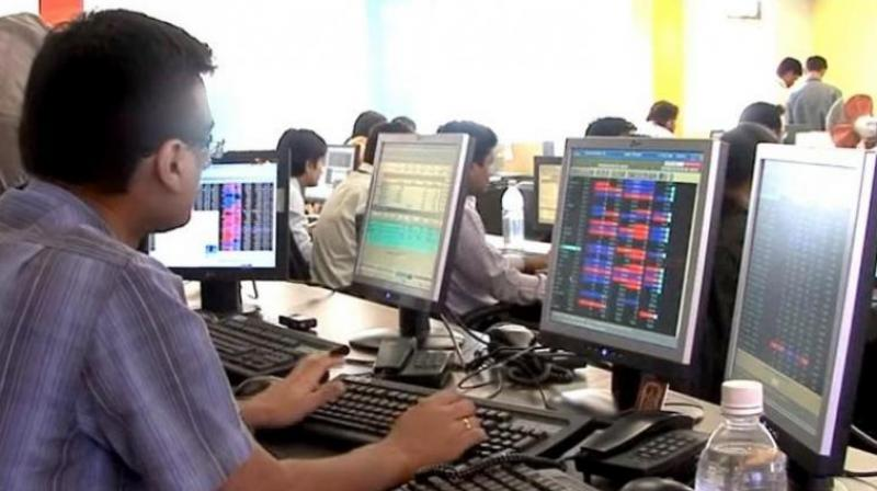 A broker at a trading session at BSE.