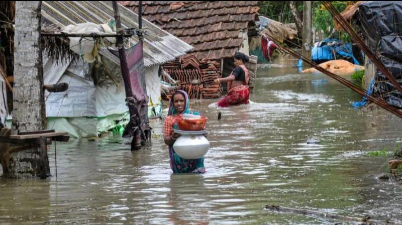 A woman wades through a water-logged road in a village after landfall of cyclone Yaas, in South 24 Paragnas. (Photo: PTI)