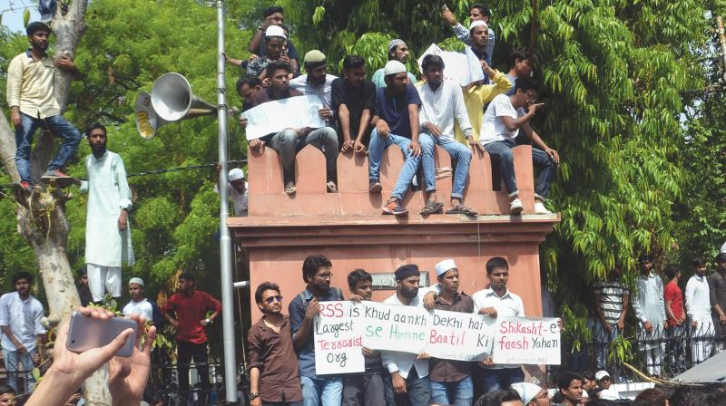 Aligarh Muslim University students stage a protest over Jinnah portrait issue on Friday. (Photo: PTI)
