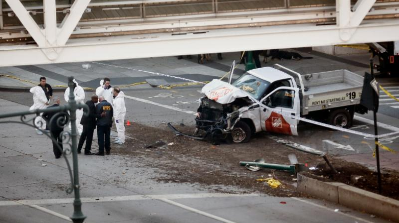 Authorities stand near a damaged Home Depot truck after a motorist drove onto a bike path near the World Trade Center memorial, striking and killing several people Tuesday in New York. (Photo: AP)