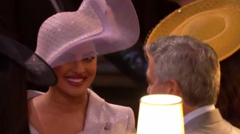 Priyanka Chopra with George Clooney at the royal wedding.