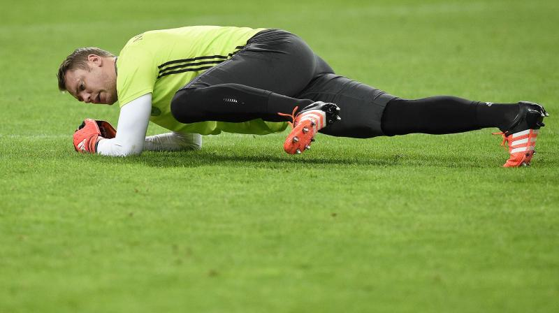 Bayern Munich goalkeeper Manuel Neuer stretches during a training session. AFP Photo