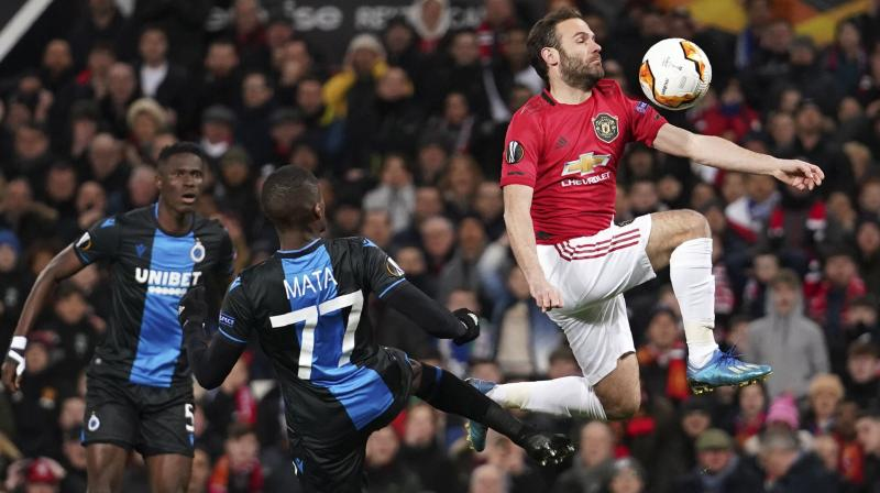 Manchester United's Juan Mata (R) controls the ball ahead of Brugge's Clinton Mata during the round of 32 second leg Europa League match at Old Trafford in Manchester, England, on Feb. 27, 2020. AP Photo