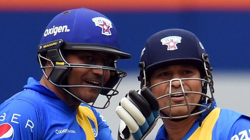 Indian cricketers Virender Sehwag and Sachin Tendulkar. AFP Photo