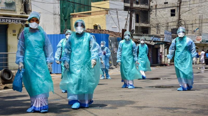 Health workers wearing protective suits prepare to disinfect a locality in Hyderabad. (PTI)