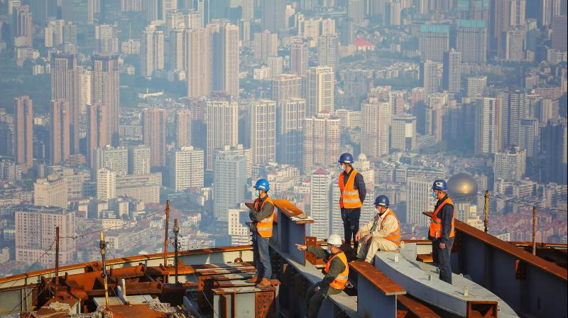 Employees are back at work at the construction site of the Wuhan Greenland Center, a 636-m high skyscraper in Wuhan in China's central Hubei province. (AFP)
