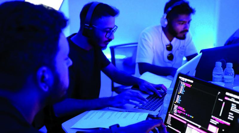Musicians live-code music during a coding jam (Photo: Algorave India)