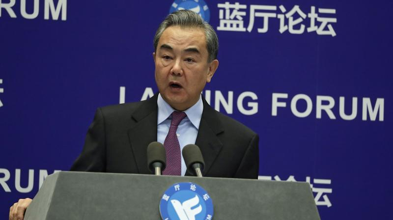 Chinese Foreign Minister Wang Yi delivers his opening remarks at the Lanting Forum on bringing China-U.S. relations back to the right track, at the Ministry of Foreign Affairs office in Beijing on Monday, February 22, 2021. (AP /Andy Wong)