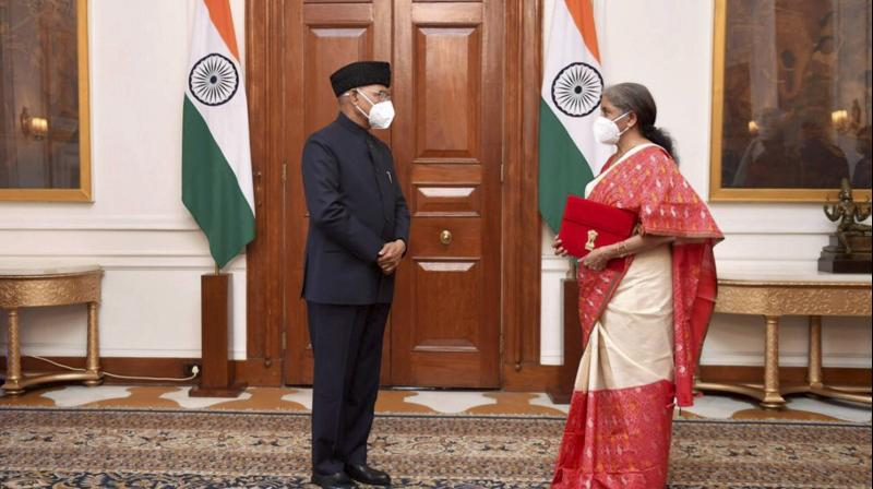 President Ram Nath Kovind with Union Finance Minister Nirmala Sitharaman, before the Budget Session of the Parliament, in New Delhi, Monday, February. 1, 2021. (PTI)