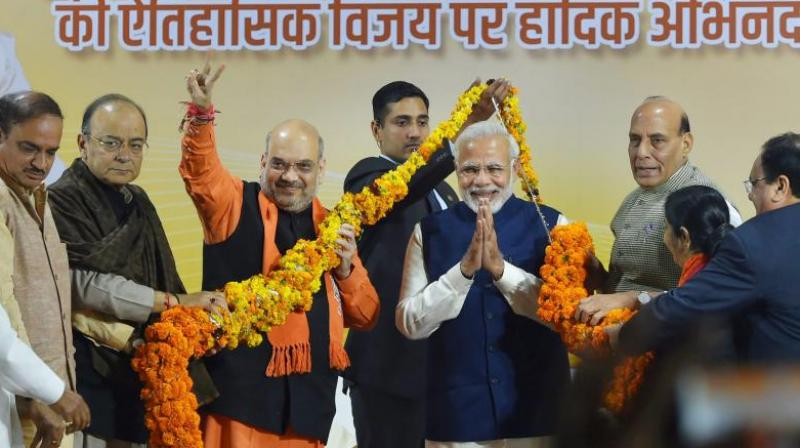 Prime Minister Narendra Modi and BJP President Amit Shah with Rajnath Singh, Arun Jaitley and Ananth Kumar at a felicitation function in New Delhi on Monday, after the party's win in Gujarat and Himachal Pradesh Assembly elections. (Photo: PTI)
